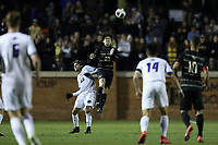 WINSTON-SALEM, NC - DECEMBER 07: Nico Benalcazar #23 of Wake Forest University heads the ball over Thibault Candia #85 of the University of California Santa Barbara during a game between UC Santa Barbara and Wake Forest at W. Dennie Spry Stadium on December 07, 2019 in Winston-Salem, North Carolina.