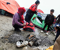 Pictured: A family start a fire at the camp Tuesday 08 March 2016<br /> Re: Heavy overnight rain has flooded the migrant camp at the Greek FYRO Macedonian border of Idomeni in Greece