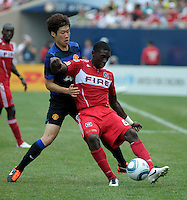 Chicago Fire forward Dominic Oduro (8) plays the ball while being pressured by  Manchester United midfielder Ji-Sung Park (13).  Manchester United defeated the Chicago Fire 3-1 at Soldier Field in Chicago, IL on July 23, 2011.