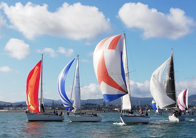At the start of Sunday's Kish Race, the keenly-raced vintage Nich 31 Saki (third left, Michael Ryan & Paget McCormack) has her spinnaker up and drawing to perfection, powering her along on a perfect sailing day for the second race of the DBSC Cruiser 3 Championship.