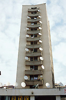 Kosovo. Pristina. Daily life.Tower block.  On most balconies are television parabol antennas for better tv reception and a wide diversity of programms.  © 2001 Didier Ruef..