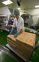 """19/06/16<br /> <br /> Barbara Strot , boxes up the lollies before they are shipped to waiting ice cream vans.<br /> <br /> """"The last couple of days have sent the factory into meltdown,"""" exclaimed Pasquale Tanzarella, director of one of the UK's largest independent ice-lolly manufacturers.<br /> <br /> In fact, today alone, his factory will make more than 200,000 ice lollies, which will be sold up and down the country through traditional ice-cream vans and shops. <br /> <br /> Demand has been so high because of the recent hot spell that the cold rooms at Franco's ices, in Kempston, Bedfordshire, are already full to bursting, with more than 40 different varieties of ice-cream and ice-lollies, and today's production of Tasty Orange lollies will probably be on sale by late afternoon.<br /> <br /> The lollies start life in a huge 2,000-litre vat, as a syrupy, bright orange liquid, before being poured into the traditional ice-lolly moulds.<br /> <br /> From there they are passed over a fast-freezer, at around -36C, to super cool the liquid into ice, which only takes around 20 minutes, before being loaded into their colourful outer wrapper.<br /> <br /> And then it's straight into wholesale boxes, stored in the factory's cold rooms, and sold the very same day.<br /> <br /> It's a super success story for this family-run business, which was founded in1964 by Pasquale's father, Domenico Tanzarella, originally to sell ice-creams through a local chain of vans.<br /> <br /> """"In the 70s we used to only supply vans within about a 60-mile radius of the factory,"""" said Pasquale.<br /> <br /> """"But we've grown steadily over the years and now we export to Cyprus, Ireland and even South Africa, as well as being one of the biggest suppliers here in the UK.<br /> <br /> """"Our best seller by far is the Mr Bubble ice-lolly,"""" said Pasquale. """"We were the very first company to launch a bubble gum flavoured lolly and it's been our best seller ever since.""""<br /> <br /> Last year they sold more tha"""