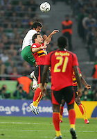 Pavel Pardo of Mexico gets higher for the ball than Figueiredo of Angola. Mexico and Angola slugged it out in a 0-0 tie in a group D game in FIFA World Cup stadium, Hannover on June 16 2006.