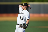 Wake Forest Demon Deacons right fielder Keegan Maronpot (13) warms up in the outfield prior to the game against the West Virginia Mountaineers in Game Four of the Winston-Salem Regional in the 2017 College World Series at David F. Couch Ballpark on June 3, 2017 in Winston-Salem, North Carolina.  The Demon Deacons walked-off the Mountaineers 4-3.  (Brian Westerholt/Four Seam Images)