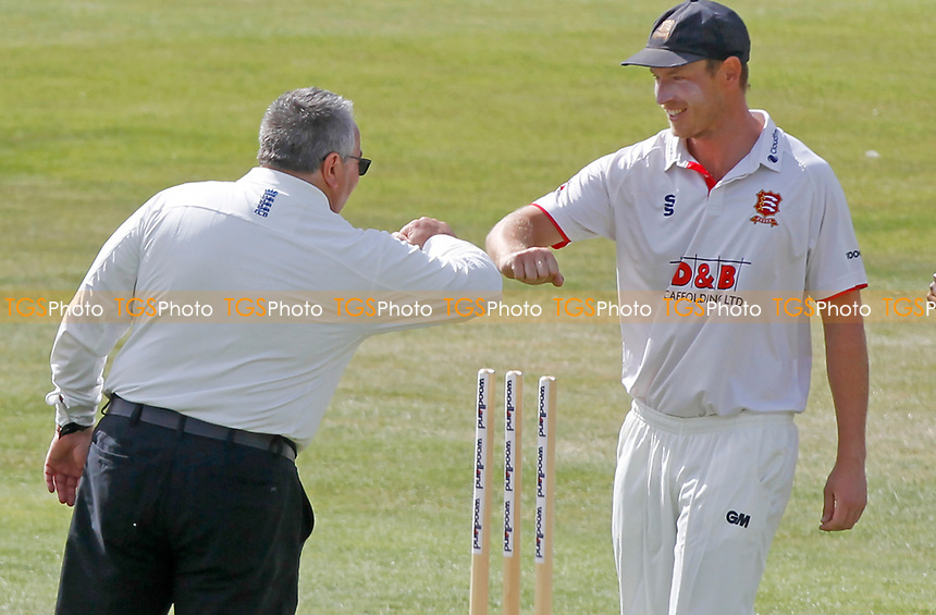 Tom Westley of Essex (right) and umpire Neil Bainton touch elbows following the coin toss during Essex CCC vs Kent CCC, Bob Willis Trophy Cricket at The Cloudfm County Ground on 1st August 2020