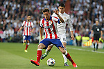 Real Madrid's James Rodriguez (R) and Atletico del Madrid´s Saul Niguez during quarterfinal second leg Champions League soccer match at Santiago Bernabeu stadium in Madrid, Spain. April 22, 2015. (ALTERPHOTOS/Victor Blanco)