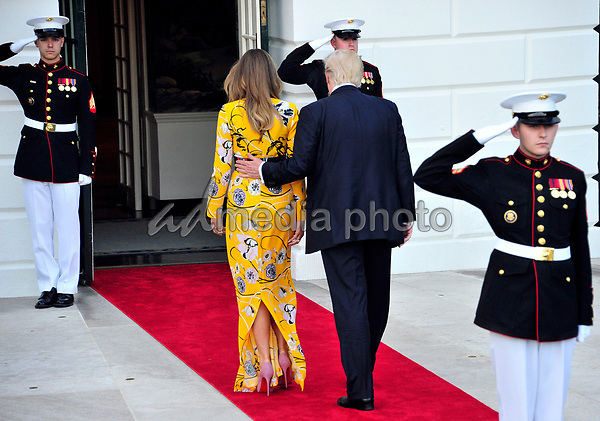 United States President Donald J. Trump and first lady Melania Trump return to the White House after bidding farewell to Prime Minister Narendra Modi of India to the White House in Washington, DC on Monday, June 26, 2017. Photo Credit: Ron Sachs/CNP/AdMedia