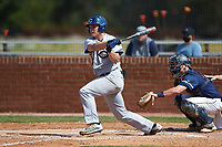 Lee Poteat (26) of the Catawba Indians follows through on his swing during game two of a double-header against the Queens Royals at Tuckaseegee Dream Fields on March 26, 2021 in Kannapolis, North Carolina. (Brian Westerholt/Four Seam Images)