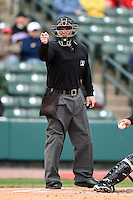 Home plate umpire Jonathan Bailey makes a call during a game between the Louisville Bats and Rochester Red Wings on May 4, 2014 at Frontier Field in Rochester, New  York.  Rochester defeated Louisville 12-6.  (Mike Janes/Four Seam Images)