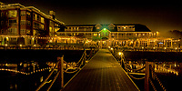 A night boardwalk view of the Hotel Eldorado with a slight smoke background visible from the BC forest fires.