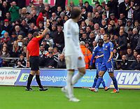 Saturday, 03 November 2012<br /> Pictured: Cesar Azpilicueta of Chelsea (R) sees a yellow card by match referee K Friend (L)<br /> Re: Barclays Premier League, Swansea City FC v Chelsea at the Liberty Stadium, south Wales.