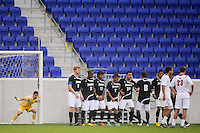 Providence Friars goalkeeper Jhojan Obando (1) sets up a wall prior to a Louisville Cardinals free kick. The Louisville Cardinals defeated the Providence Friars 3-2 in penalty kicks after playing to a 1-1 tie during the finals of the Big East Men's Soccer Championship at Red Bull Arena in Harrison, NJ, on November 14, 2010.