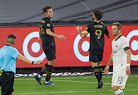 LOS ANGELES, CA - SEPTEMBER 13: Danny Musovski #16 of LAFC scores his goal and celebrates with team mate Diego Rossi #9 during a game between Portland Timbers and Los Angeles FC at Banc of California stadium on September 13, 2020 in Los Angeles, California.