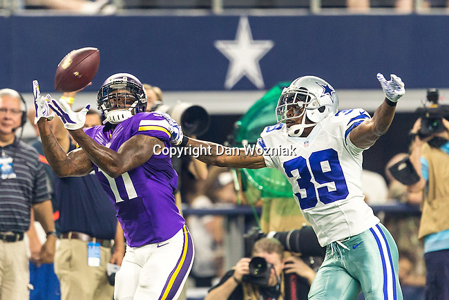 Minnesota Vikings wide receiver Mike Wallace (11) and Dallas Cowboys cornerback Brandon Carr (39) in action during the pre-season game between the Minnesota Vikings and the Dallas Cowboys at the AT & T stadium in Arlington, Texas. Minnesota defeats the Cowboys 28 to 14.