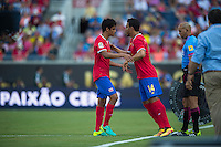 Orlando, Florida - Saturday, June 04, 2016: Costa Rican midfielder Yeltsin Tejeda (17) is sustituted for Costa Rican midfielder Randall Azofeifa (14) during a Group A Copa America Centenario match between Costa Rica and Paraguay at Camping World Stadium.