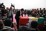 CHAMCHAMAL, IRAQ: Nechirvan Barzani pays his respects during the funeral ceremony of 104 Kurds discovered in a mass grave...On April 15, 2010, Iraqi Kurds held a ceremony to honor the 102 children and 2 pregnant women discovered in a mass grave near the town of Dibis.  They are believed to have been killed in the 1988 Anfal genocidal campaign against Iraq's Kurds.