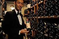 A waiter holds the popular 120,000 yen (900 euro) Petrus popualr with the Chinese in the large wine cellar of the exclusive Apicius French restaurant in the  Ginza area of Central Tokyo, 17th September, 2008.<br /><br />PHOTO BY RICHARD JONES / SINOPIX