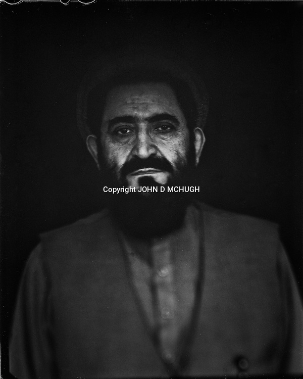 """Abdul Hakim Mujahid, former Taliban envoy to the United Nations, and now First deputy of the high Peace Council, is seen in his office in Kabul, 04 September 2012. This portrait was shot on a 5x4 Linhof Technika IV, circa 1959, and a Schneider Kreuznach 270mm lens, circa 1952, with front tilt, and is part of a series entitled """"Putting an Afghan face on the war."""" (John D McHugh)"""