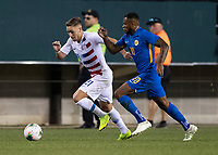 PHILADELPHIA, PA - JUNE 30: Leandro Bacuna #10 and Tyler Boyd #21 go after the ball during a game between Curaçao and USMNT at Lincoln Financial Field on June 30, 2019 in Philadelphia, Pennsylvania.