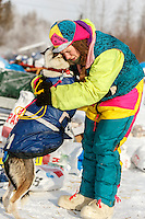 """Monica Zappa gives """"Shakara"""" a hug as she drops her because of a sore shoulder at the Tanana checkpoint Wednesday afternoon March 11th during the 2015 Iditarod.<br /> <br /> (C) Jeff Schultz/SchultzPhoto.com - ALL RIGHTS RESERVED<br />  DUPLICATION  PROHIBITED  WITHOUT  PERMISSION"""