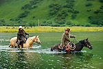 Chris and Rochelle crossing the Pasagshak River on the  Pasagshak Ranch at Kodiak Island,  Southwest Alaska