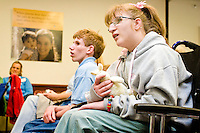 Amy Hughes enjoys the clown show at the Share and Care Network's annual retreat held at the Doubletree Guest Suites Hotel in Boston on May 20, 2006. <br /> <br /> The Share and Care Network was created in 1981 by Pat Cahill when her son Scott was diagnosed with Cockayne Syndrome.  A rare form of dwarfism, Cockayne Syndrome is a genetically determined condition whose symptoms include microcephaly, mental retardation, progressive blindness, progressive hearing loss, premature aging, and a shortened lifespan averaging 18 years.  Those afflicted have distinctive facial features, including sunken eyes, pinched faces, and protruding jaws as well as distinctive gregarious, affectionate personalities.<br /> <br /> Because of the rarity of the condition (1/1,000 live births) and its late onset (characteristics usually begin to appear only after one year), many families and physicians are often baffled by children whose health begins to deteriorate after normal development.  It was partly with this in mind that the Share and Care Network was formed, to promote awareness of this disease as well as to provide a support network for those families affected.  In 1998 it began organizing an annual retreat, which has grown from three families in its inaugural year to more than 30 today.  Although the retreat takes place in the United States, families from as far as Japan arrive for this one weekend out of the year to share information and to support one another.