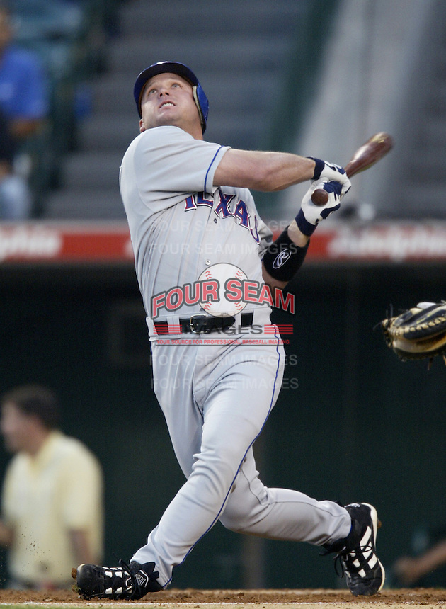 Todd Greene of the Texas Rangers bats during a 2002 MLB season game against the Los Angeles Angels at Angel Stadium, in Los Angeles, California. (Larry Goren/Four Seam Images)