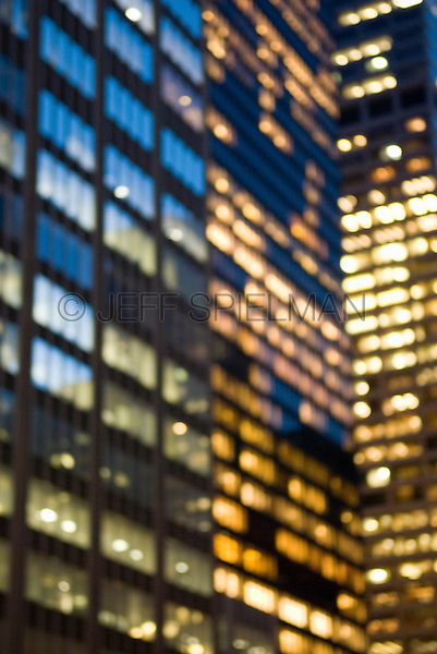 AVAILABLE FROM GETTY IMAGES FOR COMMERCIAL AND EDITORIAL LICENSING.  Please go to www.gettyimages.com and search for image # 115925722.<br /> <br /> Soft Focus/Defocused view of Office Buildings in Midtown Manhattan, windows illuminated at night....New York City, New York State, USA
