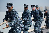 130422-N-DR144-203 SAN DIEGO (April 22, 2013) Sailors take in mooring lines as Amphibious Transport Dock Ship USS Anchorage (LPD 23) gets underway from its homeport of San Diego. Anchorage is en route to its namesake city of Anchorage, Alaska for its commissioning ceremony, scheduled to take place May 4. (U.S. Navy photo by Mass Communication Specialist 1st Class James R. Evans / RELEASED)
