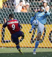 LA Galaxy GK Joe Cannon (1) defends his goal beating RSL FWD Alecko Eskandarian (9) to the ball. The LA Galaxy beat Real Salt Lake 3-2 at the Home Depot Center in Carson, California, Sunday, June 17, 2007.