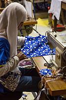 Yogyakarta, Java, Indonesia.  Batik Workshop.  Woman Sewing Batik Cloth.