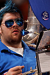 A member of the Kentucky band, who plays the tuba, looks on during the game.  Connecticut defeated Kentucky 87-83 in the second round of the NCAA Tournament  at the Wachovia Center in Philadelphia, Pennsylvania on March 19, 2006.
