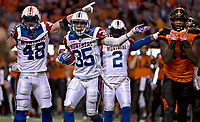 Vancouver, September, 09, 2016 - Montreal Alouettes [L-R] Bear Woods, Greg Henderson and Jovon Johnson signal to the team bench as Lions' Geraldo Boldewijn watches on. The Montreal Alouettes lost to the BC Lions 27 -38. (Andrew Soong)