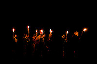 Clans march in by candlelight during the 52nd Annual Grandfather Mountain Highland Games in Linville, NC.