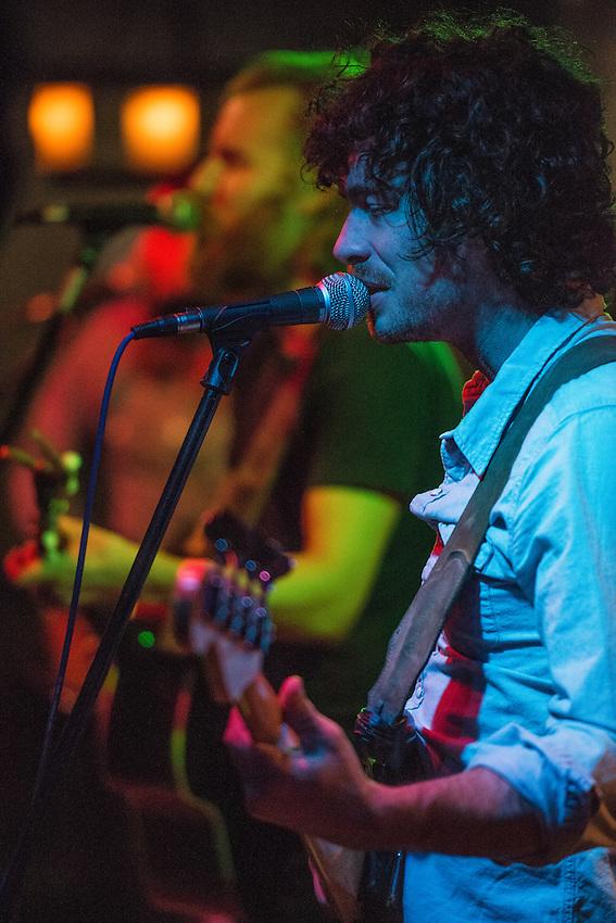 Bassist Luke Long rocking during Ha Ha Tonka's Friday night performance at Tap Root.