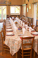 Lunch table set for many guests ready to be served duck specialities. Ferme de Biorne duck and fowl farm Dordogne France