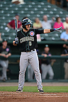 Kane County Cougars third baseman David Bote (5) tells a runner to go on a past ball while at bat during a game against the Peoria Chiefs on June 2, 2014 at Dozer Park in Peoria, Illinois.  Peoria defeated Kane County 5-3.  (Mike Janes/Four Seam Images)