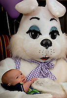 A young boy is held by the Easter Bunny during a holiday party at Berewick master-planned community in southwest Mecklenburg County, Charlotte, NC. The property is developed by Pappas Properties.