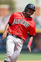 Josh Bell (18) of the Indianapolis Indians rounds third base against the Charlotte Knights at BB&T BallPark on June 19, 2016 in Charlotte, North Carolina.  The Indians defeated the Knights 6-3.  (Brian Westerholt/Four Seam Images)