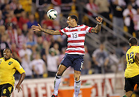 COLUMBUS, OHIO - SEPTEMBER 11, 2012:  Jermaine Jones (13) of the USA MNT gets to a high ball between Jermaine Taylor (6) and Dwayne Miller (13)  of  Jamaica during a CONCACAF 2014 World Cup qualifying  match at Crew Stadium, in Columbus, Ohio on September 11. USA won 1-0.