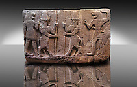 Picture of Neo-Hittite orthostat describing the legend of Gilgamesh from Karkamis,, Turkey. Mythological scene. The 2 figures in the center are flanked by lion headed men who have one fist outstretched and are known as Ugallu. The 2 figures in the middle holding spears are men with bodies of bulls known as Kusarikku. An Ankara Museum of Anatolian Civilizations exhibit.