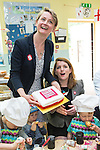 © Joel Goodman - 07973 332324 . 14/06/2016 . Burnley , UK . Yvette Cooper MP and Alison McGovern MP pose with a Vote Remain cake whilst campaigning for Remain , in the EU referendum , at Giant Leap Child Care and Learning House in Burnley . Photo credit : Joel Goodman