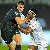 8th October 2021;  Swansea.com Stadium, Swansea, Wales; United Rugby Championship, Ospreys versus Sharks; Owen Watkin of Ospreys tries to fend off Phepsi Buthelezi of Cell C Sharks