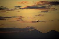 Bush plane on floats flies over mountains, Katmai National Park, Alaska.