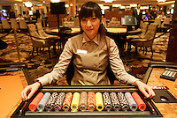 A 'Baccarat' dealer shortly before the 'MGM Grand Macau' casino  Macau. The ex-Portuguese colony of Macau in South China is a mecca for gamblers in Asia and especially China and makes more money that Las Vegas.