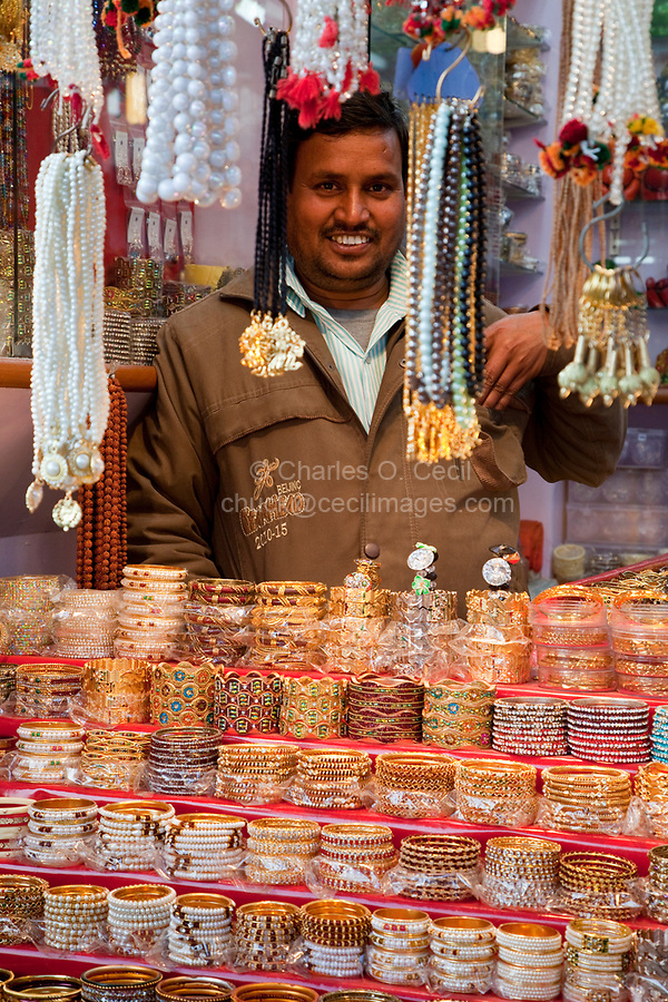 India, Rishikesh.  Jewelry Shop Vendor  with Bracelets and Necklaces.