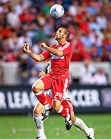 Chicago Fire defender Daniel Woolard (24) heads the ball out of danger.  Chicago Fire defeated Toronto FC by the score of 2-1 at Toyota Park stadium, in Bridgeview, Illinois on Saturday, July 12, 2008.