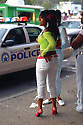 Young woman in Treme watch the police go by, 2005
