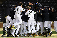 The Wake Forest Demon Deacons celebrate at home plate following a walk-off solo home run by William Simoneit (not pictured) in the bottom of the ninth inning against the Louisville Cardinals at David F. Couch Ballpark on March 7, 2020 in  Winston-Salem, North Carolina. The Demon Deacons defeated the Cardinals 3-2. (Brian Westerholt/Four Seam Images)