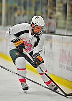 28 January 2012: University of Vermont Catamount forward Brett Leonard, a Senior from South Burlington, VT, in action against the Northeastern University Huskies at Gutterson Fieldhouse in Burlington, Vermont. The Catamounts, dressed in their Breast Cancer Awareness jerseys, fell to the Huskies 4-2 in the second game of their 2-game Hockey East weekend series. Mandatory Credit: Ed Wolfstein Photo